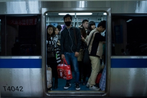 Passengers ride the Beijing Subway in Beijing, China in October 2014
